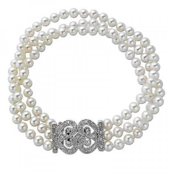"""4.5 - 5.0mm Cultured Freshwater Pearl and 1/7 CT. T.W. Diamond Three Strand Bracelet in Sterling Silver - 8"""""""